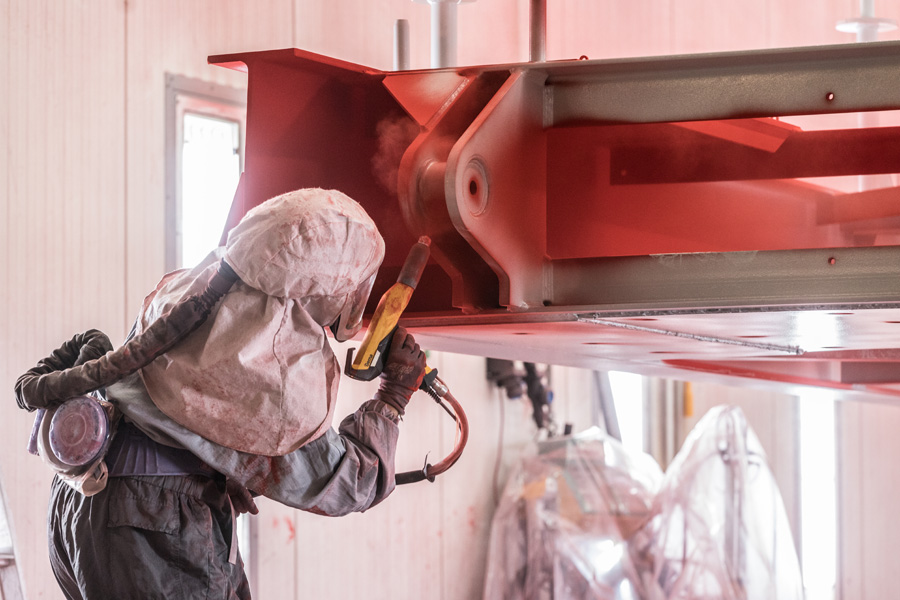 Foto von der Arbeit in unserer Pulverbeschichtungsanlage