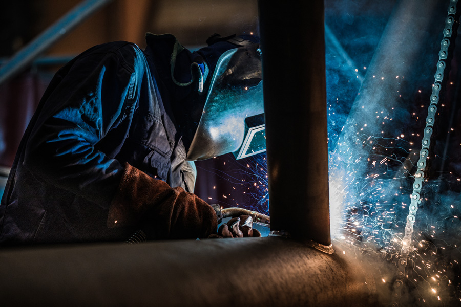 Picture of a welder at the WILBERT manufacturing site